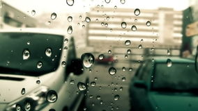 Rain dripping down the window - graded artisticall stock video footage