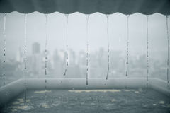Rain dripping from roof Stock Image