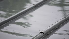 Rain dripping on the steel gray roof, loneliness and depression, bad weather. Stock footage stock video