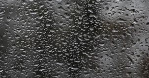 Rain dripping on the windshield of the car, Slow motion. 4K stock video footage