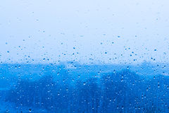Rain Drop on Blue Glass Stock Photography