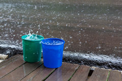 Rain drop in bucket water, weather rainy Royalty Free Stock Photo