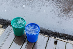 Rain drop in bucket water, weather rainy Royalty Free Stock Photos