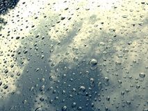 Rain drop on a car. Background for water drop on a screen of a car in the morning Royalty Free Stock Photo