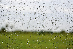 Rain drop on the car glass, Abstract blur background Stock Images