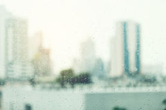 Rain drop. Rain dropping at a window or high building with a city view outside,city life concept Stock Photos