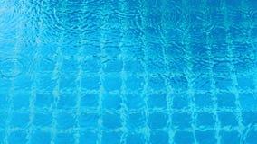 Rain drop falling on swiming pool. Rain drop falling on swiming pool and ripple shape and sun light reflection on water surface Royalty Free Stock Photo