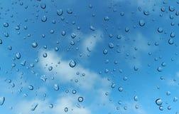 Rain drop on glass against blue sky Royalty Free Stock Photos