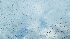 Rain drop on glass stock footage