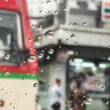 Rain drop. On the glass of bus on traffic road Royalty Free Stock Images