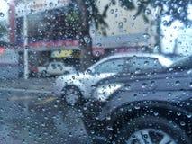 Rain drop on glass with car on road. Rain drop on Stock Photo