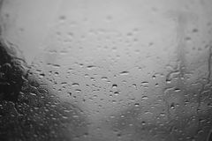 Rain drop on a glass with focus on a center, high contrast black and white picture style Stock Images