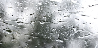 Rain drop on glass Stock Images