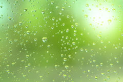 Rain drop on the mirror with green natural light Royalty Free Stock Photo