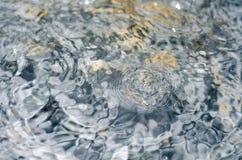 Rain drop over water surface Stock Photo