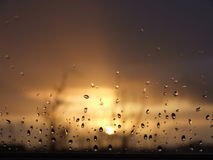 Rain Drop Sunset. Closeup of rain droplets on glass during a Summer sunset in Ireland Royalty Free Stock Photography