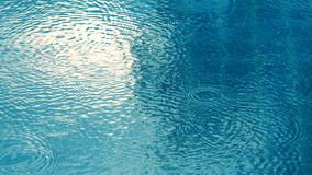 Rain drop on the surface of swiming pool. Royalty Free Stock Photo