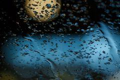 Rain drop on the window and bokeh blur background abstract.  Stock Images