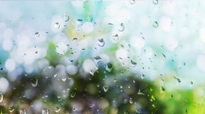 Rain drop on window glass plate with romantic Royalty Free Stock Images