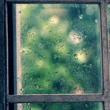 Rain drop on window. In rainy day, glass with green background as seperation, nice background for love Stock Photo
