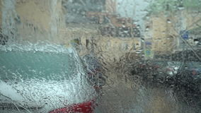 Rain drop on the windshield on the day of rain. FullHD video stock footage