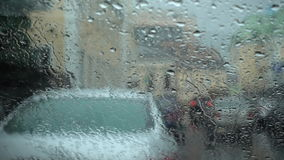 Rain drop on the windshield on the day of rain. FullHD video stock video footage