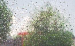 Rain droped on the window. blurred background. Raining droped on the window. blurred background Royalty Free Stock Photo
