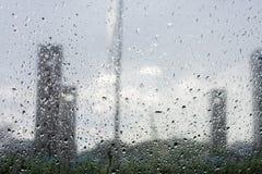 Rain droped on the window. blurred building. Raining droped on the window. blurred building Stock Photography