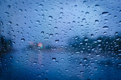Rain droplet on a glass. At night scene Stock Photo