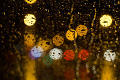 Rain droplet on a glass. At night scene Stock Photos