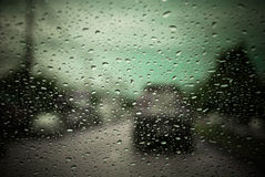 Rain droplets on car windshield, blocked traffic Stock Images