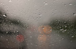 Rain droplets on car windshield, blocked traffic Royalty Free Stock Photo