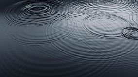 Rain Droplets on Water Surface Royalty Free Stock Images