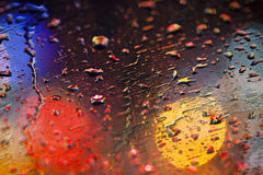 Rain Drops. On windshield with colorful bokeh on background Royalty Free Stock Photo