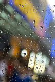 Rain drops. On window glass, neon lights in background Stock Images