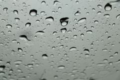 Rain drops on car front window in rainy day. Water drops Royalty Free Stock Photography