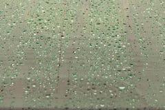 Rain drops on the car glass . Rain drops background.  Royalty Free Stock Image