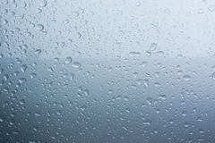 Rain drops on car with glass coating skin Royalty Free Stock Photo