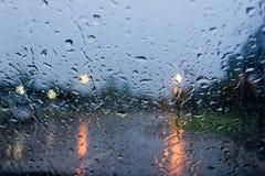 Rain drops on car glass Stock Photos