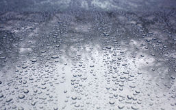 Rain drops on a car low Royalty Free Stock Photo