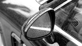 Rain drops on car mirror after water protection repellent coating Royalty Free Stock Image