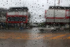Rain drops on a car window on the street. Royalty Free Stock Photo