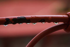 Rain drops on a chair. Water drops Royalty Free Stock Photos