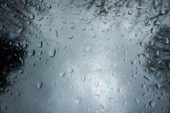 Rain drops. Cloudy raining dark black background Stock Images