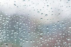Rain drops on dark window glass. Abstract background texture. D stock image