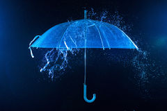 Rain drops falling on  umbrella Stock Image
