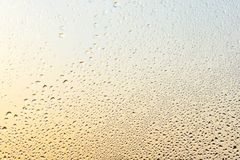 Rain drops and frozen water on window glass background. Golden and silver colors Royalty Free Stock Photography