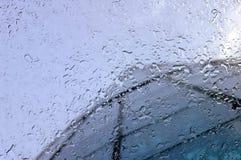 Rain drops through glass Royalty Free Stock Photography