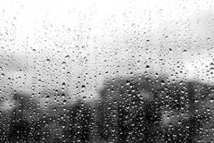 Rain drops on glass. Abstract vintage background - Rain drops on glass black and white color tone Royalty Free Stock Photography