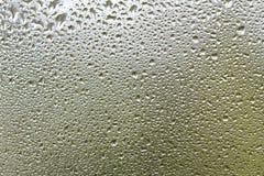 Rain drops on a glass background texture stock photos